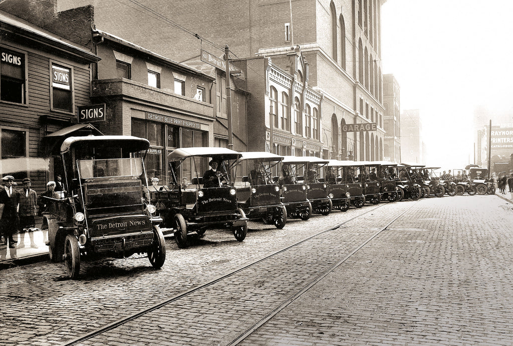 The cover image, courtesy of The Detroit News Photo Archive, features a fleet of Detroit News trucks lined up on Congress, looking west, between Shelby and Wayne (now Washington Boulevard), circa 1912–14.