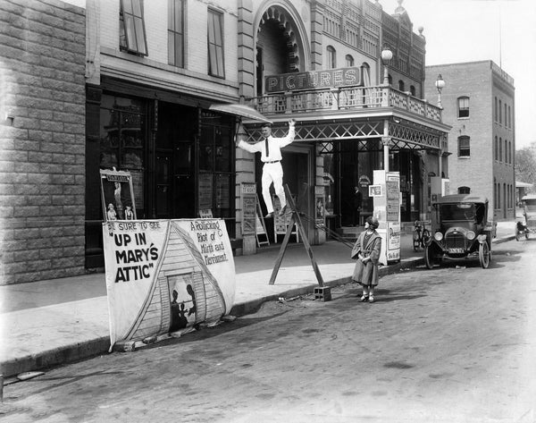 A man walking a tight rope in front of the Ludcke Theatre in St. Peter, circa 1920. -- Courtesy Nicollet County Historical Society
