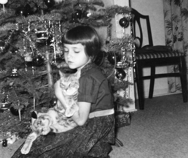 "Paula Savino and rescued kitten ""Fuzzy"" at their home in Fresno, Christmas 1956. -- PAULA SAVINO"