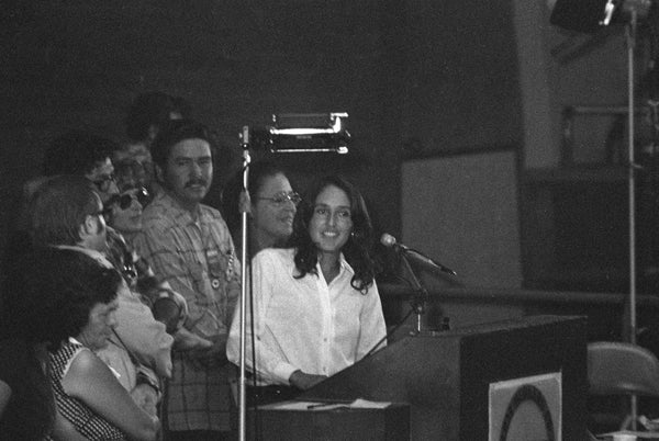 Folk artist Joan Baez sings at the First Constitutional Convention of the United Farm Workers Union, September 21, 1973. -- Courtesy Howard Watkins