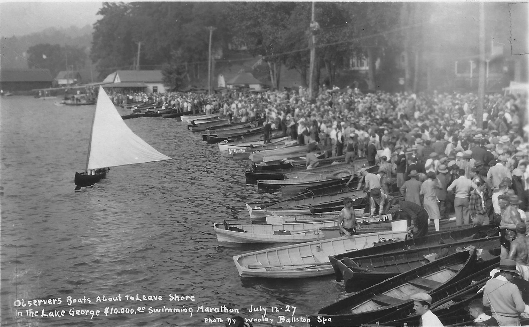 "The Lake George Swimming Marathon, held in July of 1927, drew 146 competitors from six countries and nearly every state in the U.S. Heavyweight boxing champion Jack Dempsey traveled to Hague to fire the starting pistol. Prizes included $10,000 in cash, valuable real estate as well as cups and medals. The 24-mile course set up for the marathon ran from the Trout House in Hague to the Fort William Henry Hotel. Eighteen and one half hours after the start in Hague, New York City swimmer, Edward Keeting, crossed the finish line in Lake George Village. Former Hague Historian Clifton West, who was 18 at the time of the marathon, remembered that so many people had crowded onto the platform leading out to the pier, that it gave way when Dempsey stepped onto it, sending him and about a dozen of his fans into the ankle-deep water. Dempsey was unscathed, though his fashionable shoes were soaked through. Rule #12 stated: ""Any class of bathing suit… can be used. Suits can be abolished entirely if swimmer chooses to use a covering only of grease."" Warren County Sanitary Inspector Harry Smith announced before the race that the grease could jeopardize the quality of Lake George's water. The swimmers, however, rallied at the Lake George Courthouse and were able to convince him that the grease was a natural substance (wool fat or lanolin) and would not harm the lake. -- Hague Historical Society"