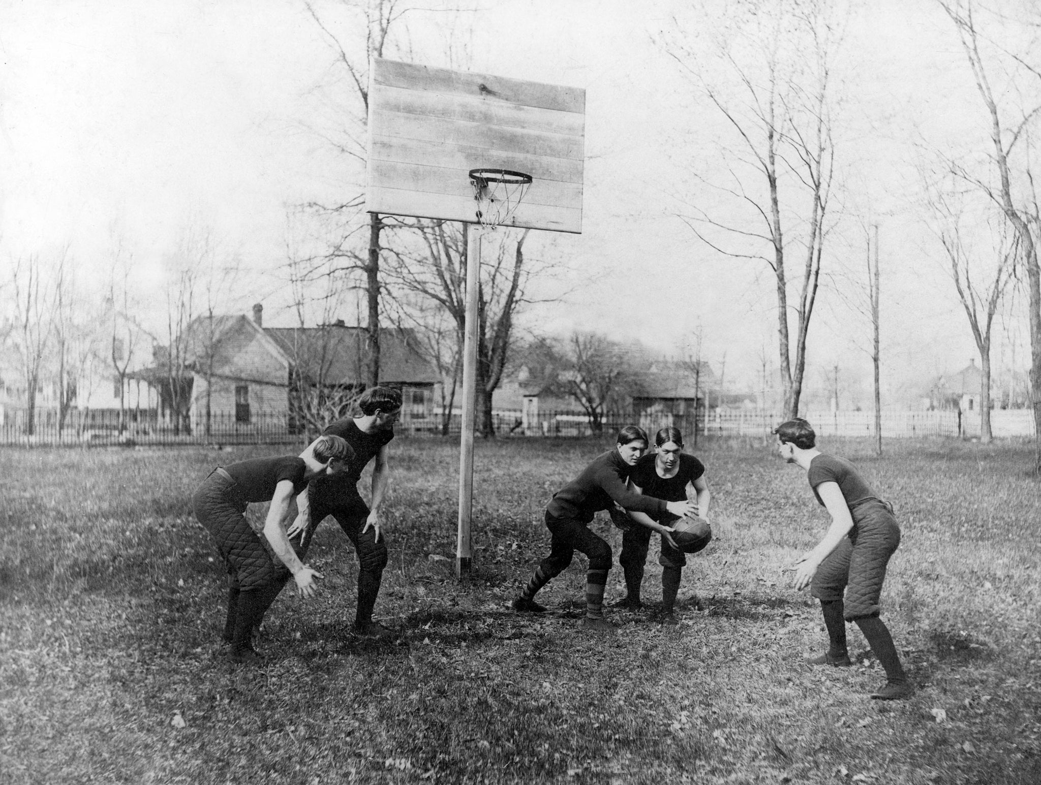 Boys practicing basketball on the Southern Illinois Normal University campus, circa 1904. -- Southern Illinois University Archives, Southern Illinois University Carbondale Collection, Box 1-Folder 10