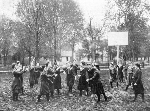Girls playing basketball on the Southern Illinois Normal University campus, circa 1904. -- Southern Illinois University Archives, Southern Illinois University Carbondale Collection, Box 1-Folder 17