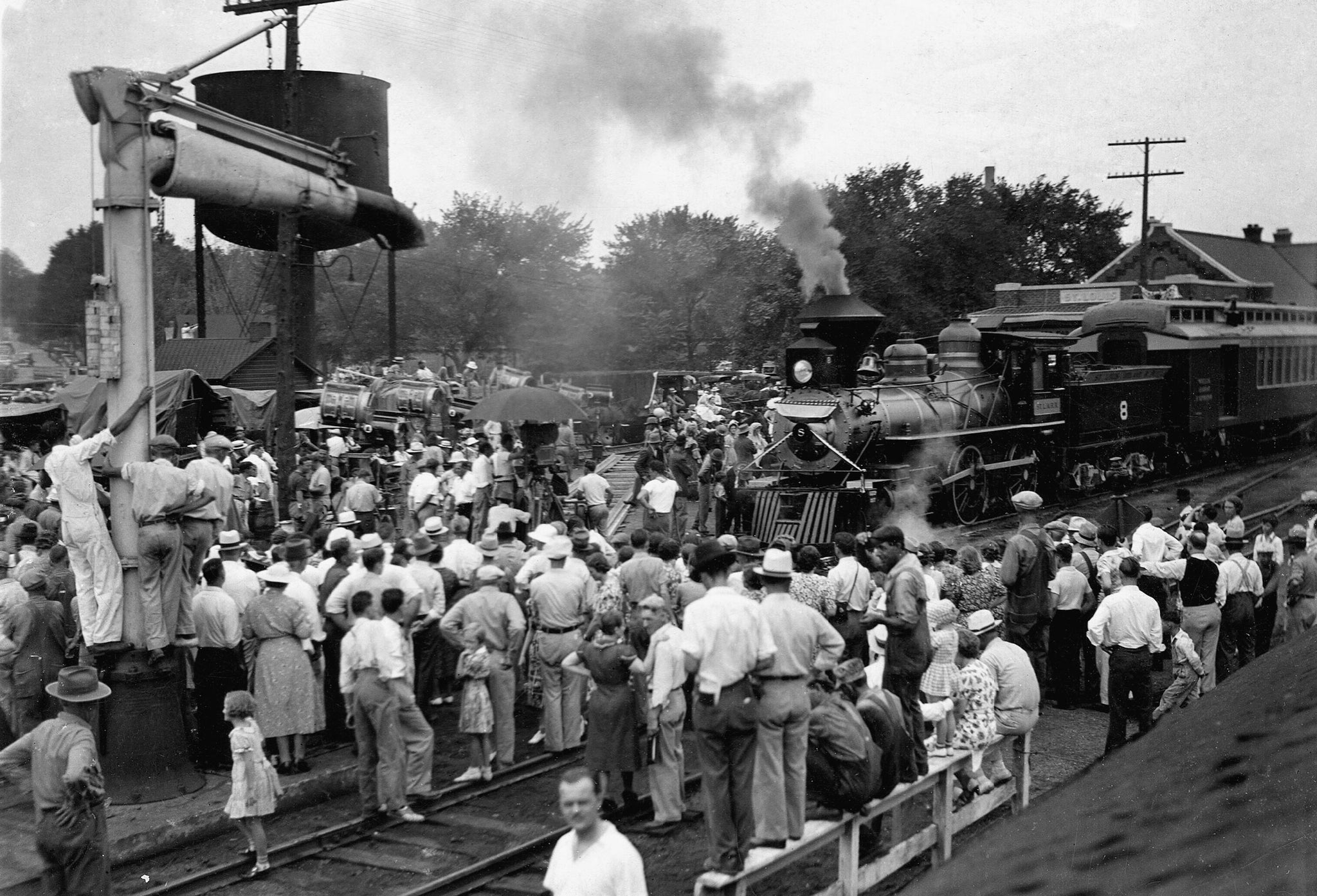 Spectators watch the robbery scene for Jesse James, which was filmed at the train station in Southwest City, 1938. -- Courtesy of Deanna Booyer, Newton County Historical Society & Park