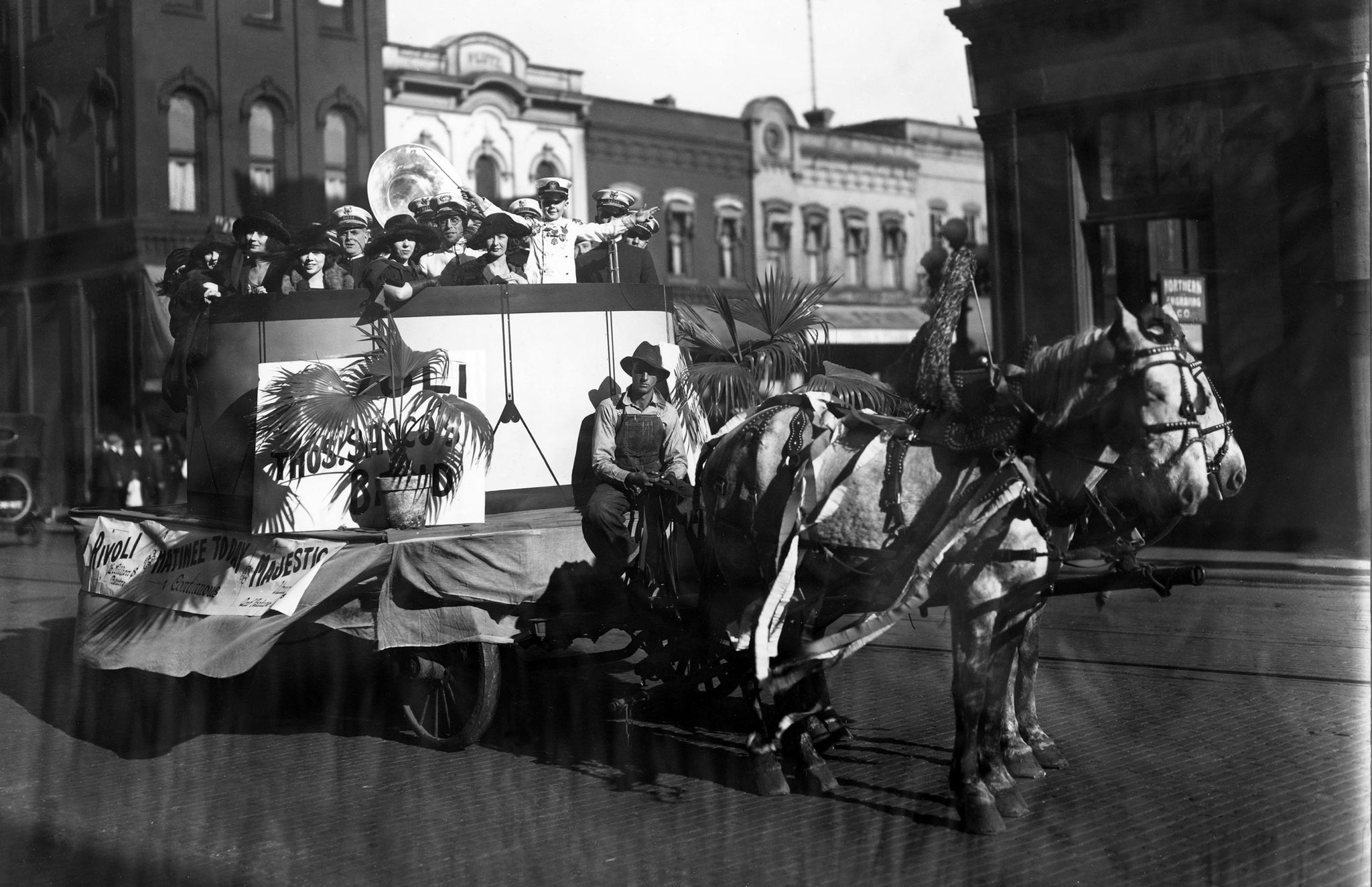 "The Thomas Sacco Band from New Orleans on a parade float sponsored by the Rivoli Theatre in October 1922. The band was led by a 7-year-old boy known as ""Little Sousa."" -- Courtesy University of Wisconsin-La Crosse / #3105"