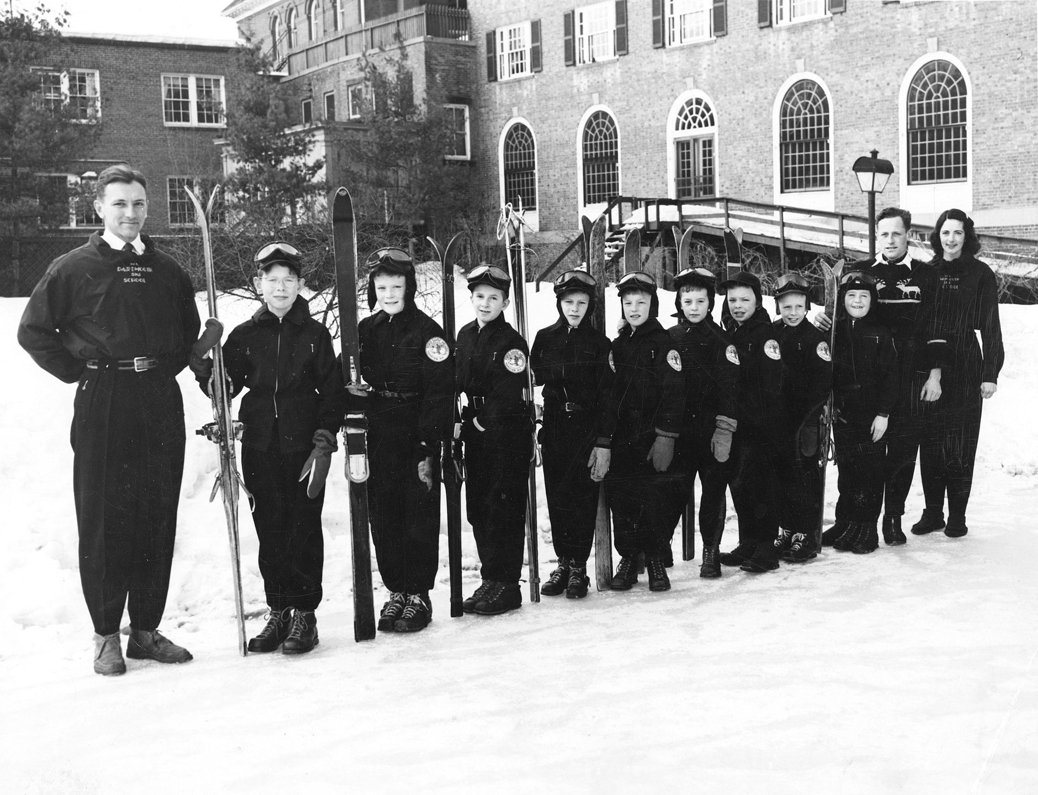 "Ford Sayre Ski Team on the skating rink beside Hanover Inn, 1949. From left: Jerry Hickson, Philip Jensen, Bill Aldrich, Jerry Burt, Rick Barrett, Robert Fuller, Lawrence Gazley, Bill Orcutt, Peter Sadler, Peter Coyle, Al Peavey, Elizabeth ""Lib"" Fitzgerald. -- Courtesy Norwich Historical Society"