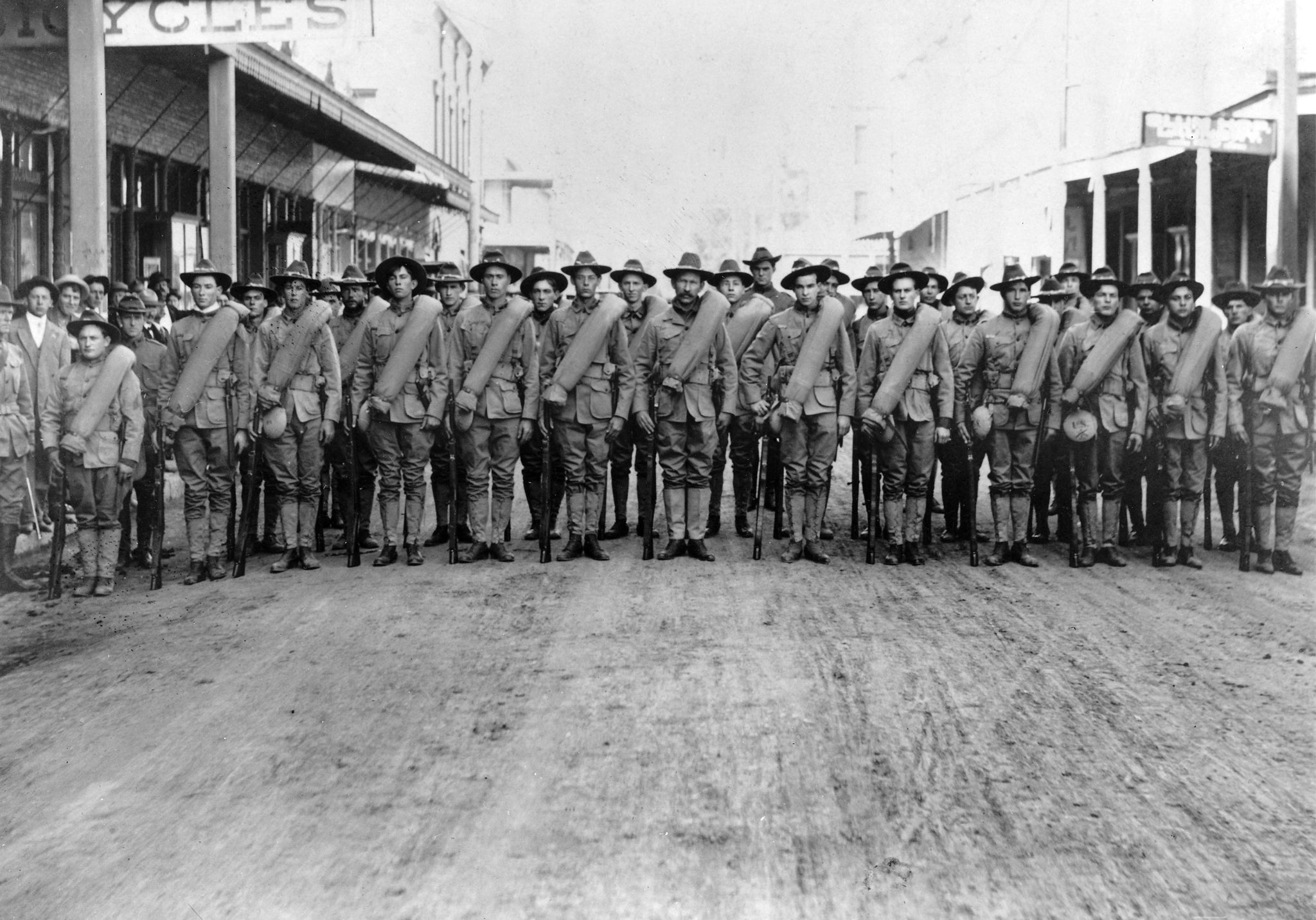 Company F. Second Infantry lined up on Main Street prior to leaving for induction into federal service for the Spanish-American War, Woodland, 1894. -- Courtesy of Yolo County Archives
