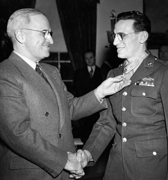Sergeant Vito Bertoldo receiving the Congressional Medal of Honor from President Truman for his service in Hatten, France during World War II, January, 1945. -- Brent Wielt