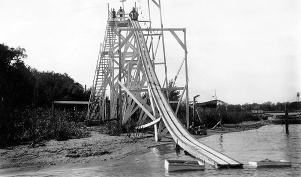 People enjoying a slide at Madison Lake, circa 1920. -- Courtesy Blue Earth County Historical Society