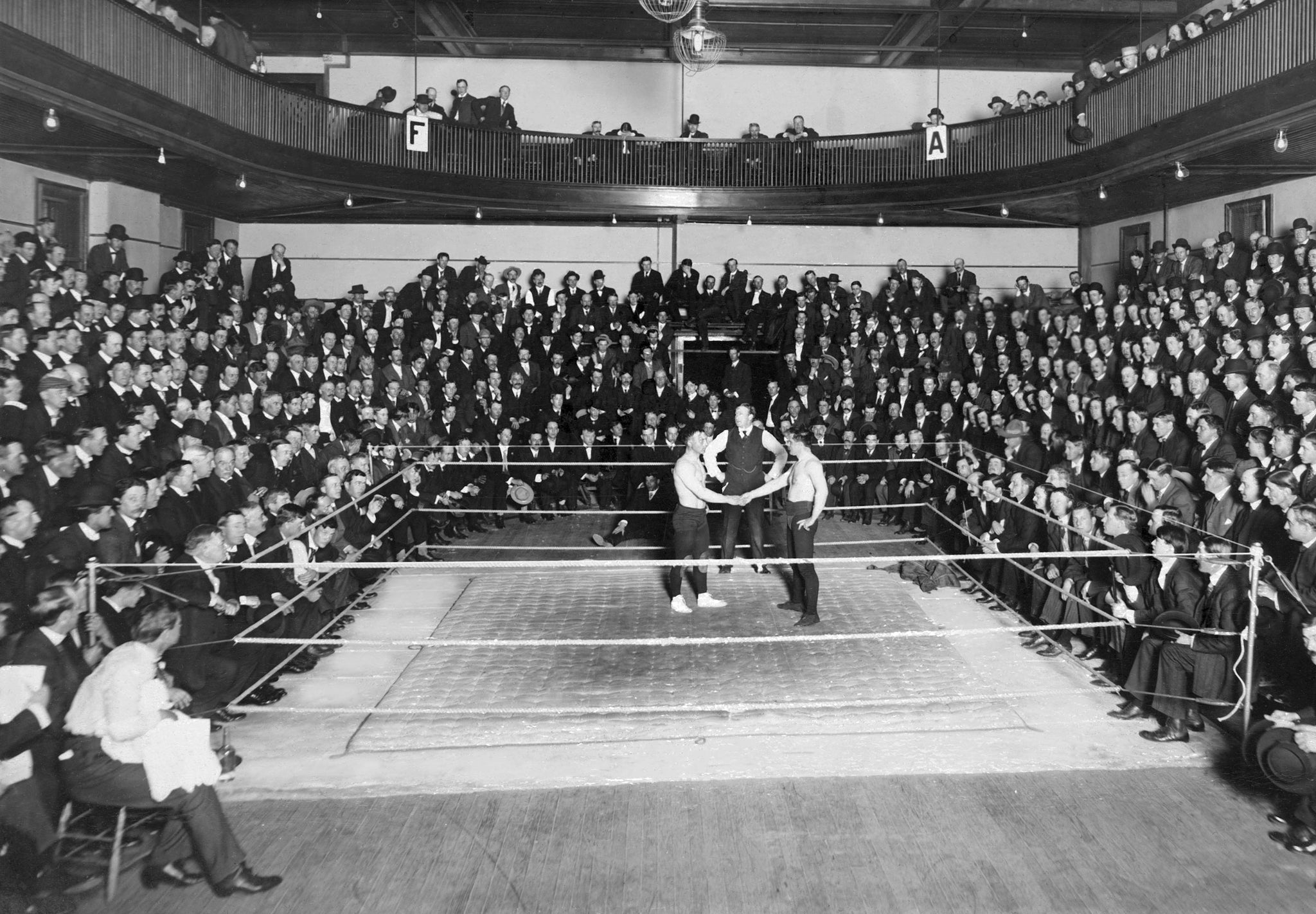 Fred Beell, on left, wrestling at the armory on Second Street, circa 1913. Beell retired from wrestling undefeated in 1919, holding the light, medium and heavyweight crowns. -- Courtesy North Wood County Historical Society / #U108.31