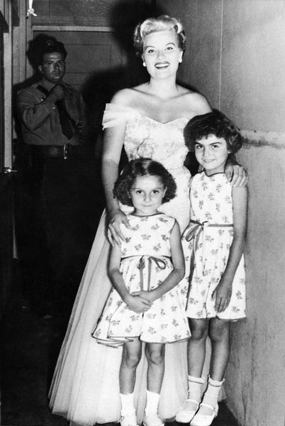 Patti Page with sisters, Joan and Linda DiPrima, back stage at the Frolics, Salisbury Beach, July 13, 1954. Police Officer, Joe Messina can be seen in back. -- Courtesy Joan Petersen