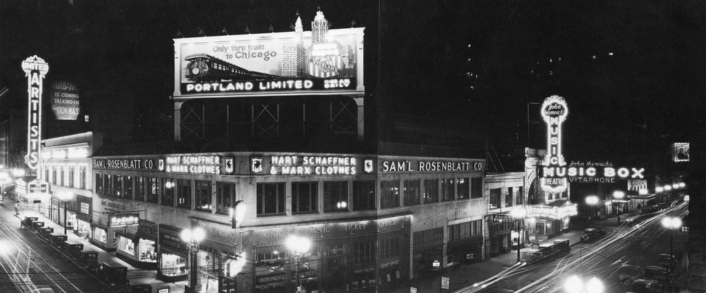 A view of the brightly lighted corner of Broadway and Washington in 1929.