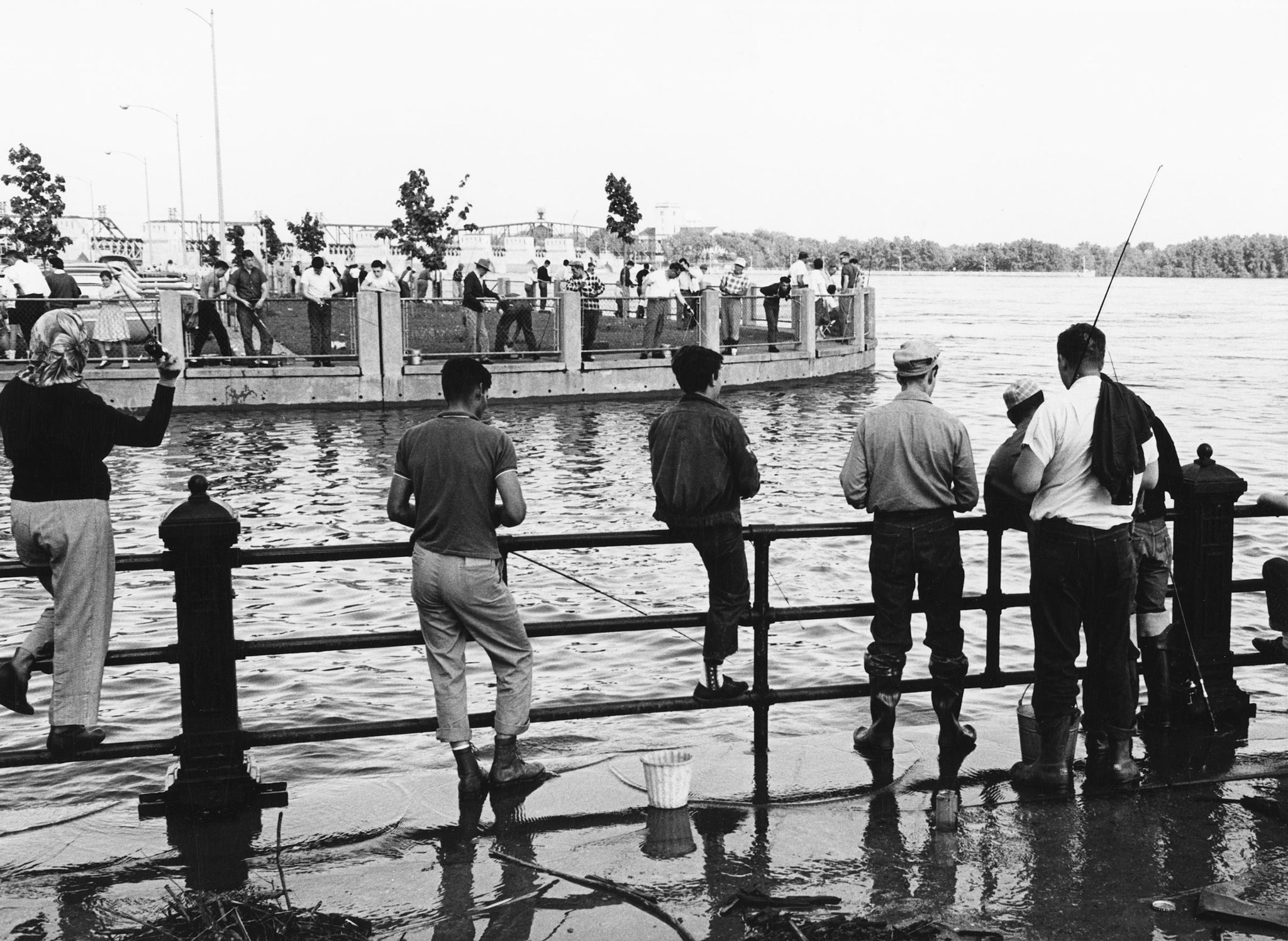 People fishing in the Mississippi River during flooding in Davenport, 1965. -- Quad-City Times