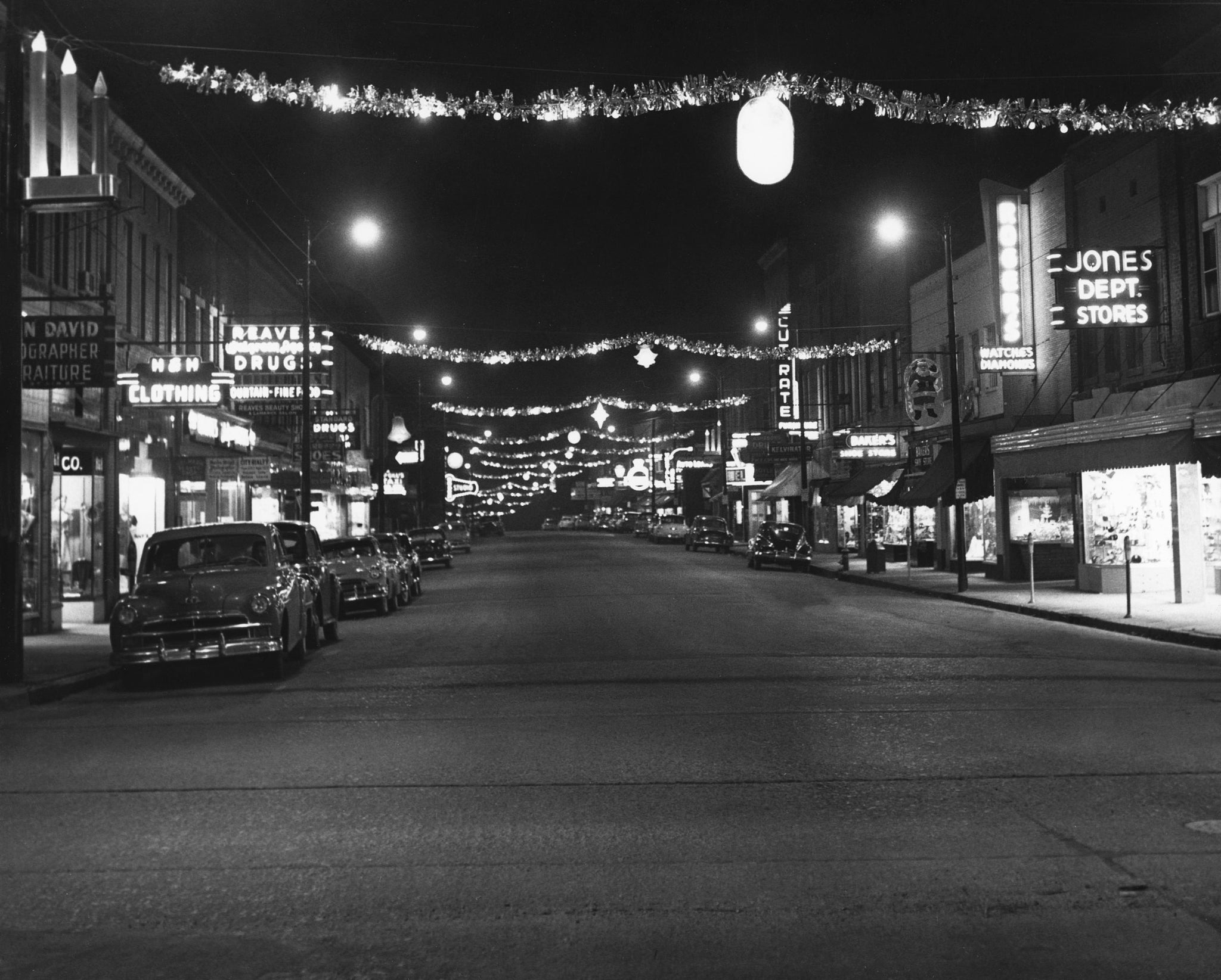 Christmas decorations hanging over Sunset Avenue in Asheboro, 1946. -- Randolph County Public Library