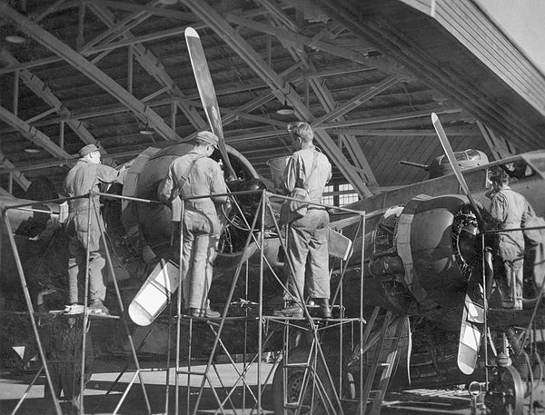 Mechanics working on a B-17 at the Sioux City Army Air Base, 1944. -- SIOUX CITY PUBLIC MUSEUM