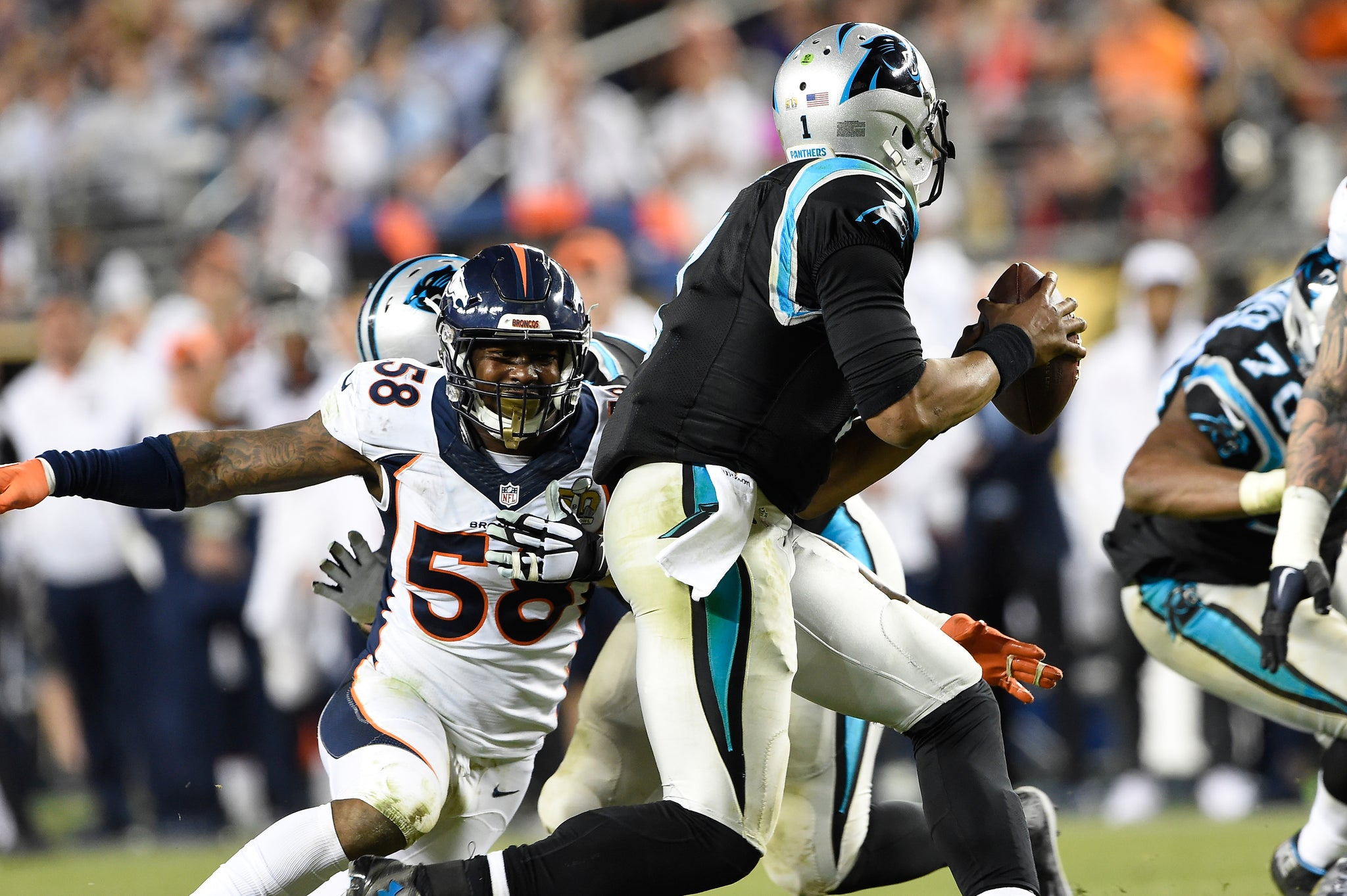 Von Miller (58) of the Denver Broncos sets his sights on Cam Newton (1) of the Carolina Panthers in the fourth quarter of Super Bowl 50.  -- Photo by Joe Amon/The Denver Post