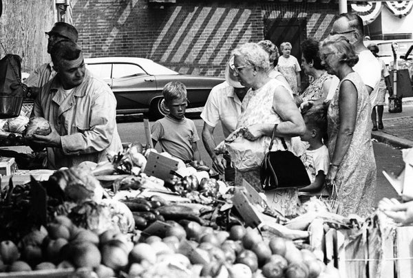 Shoppers peruse the offerings at the Derby Square market, circa 1971. -- Courtesy Phillips Library, Peabody Essex Museum
