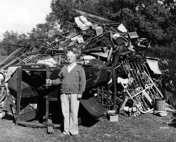 Chesterton Town Marshal Joe LaRoche in front of scrap metal collected during a drive for World War II, 1942. -- WESTCHESTER TOWNSHIP HISTORY MUSEUM