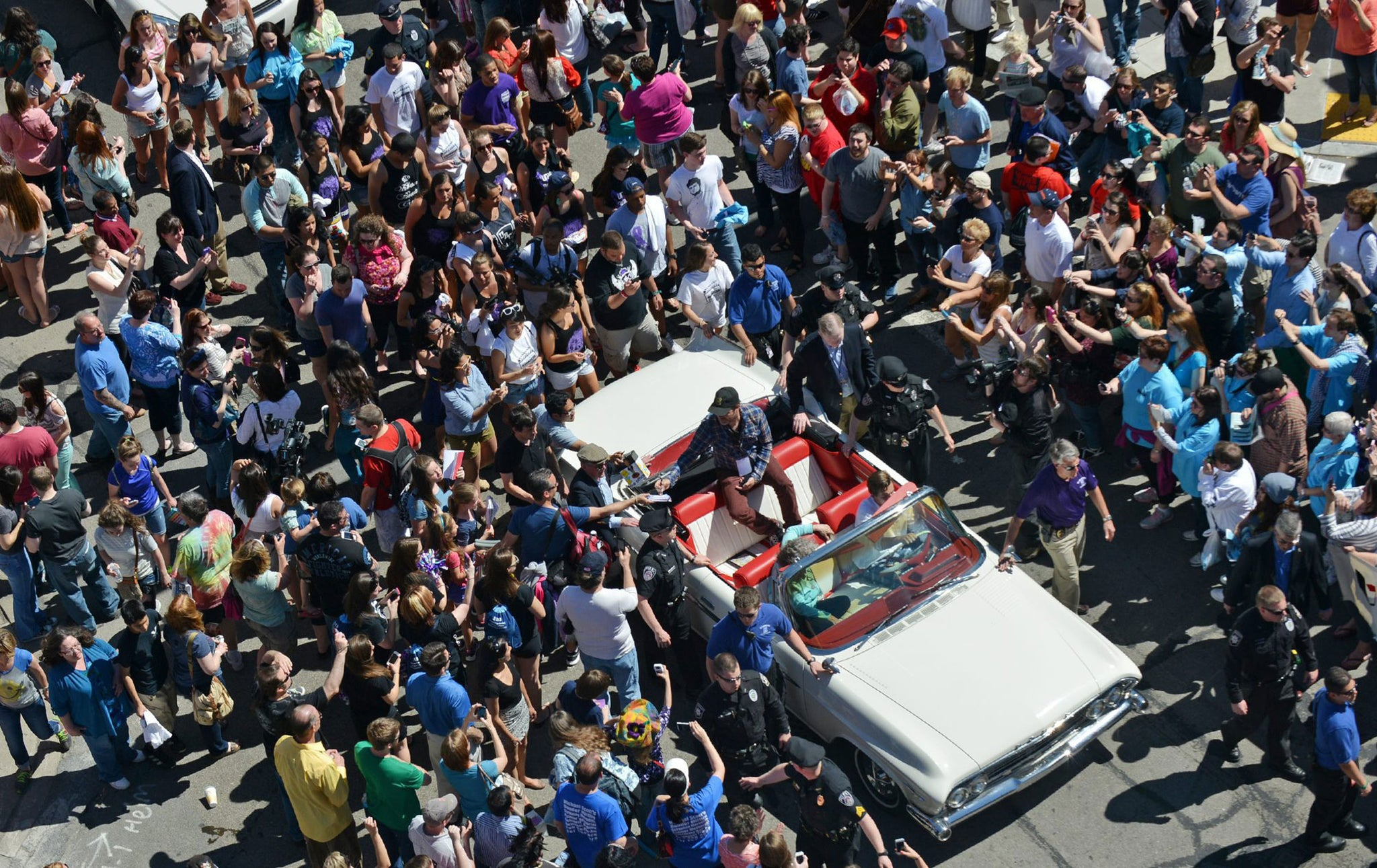 "Rainn Wilson, from ""The Office"" is surrounded by fans during the parade from the University of Scranton to Courthouse Square, as part of ""The Office"" Wrap Party on May 4, 2013. -- Scranton Times-Tribune Archives"