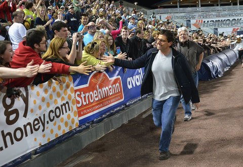 "Steve Carell made a surprise appearance at ""The Office"" Wrap Party at PNC Field, as he runs down the line high-fiving fans. -- Scranton Times-Tribune Archives"