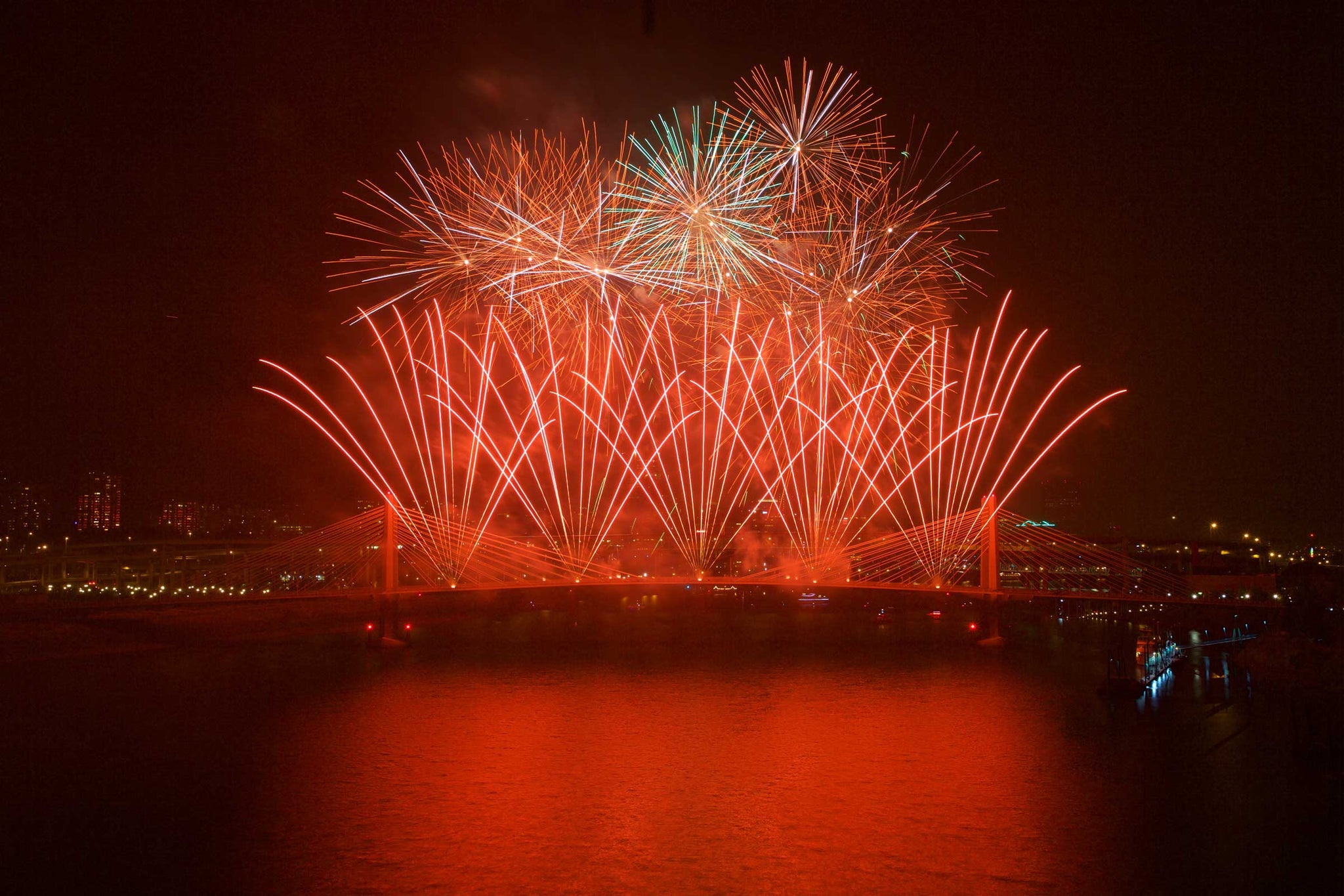 Trimet launched fireworks off the new Tilikum Crossing Bridge to cap their MAX Orange line picnic at the Zidell Yards next to the Willamette River on Saturday, Aug. 22, 2015. -- Randy L. Rasmussen/The Oregonian/OregonLive
