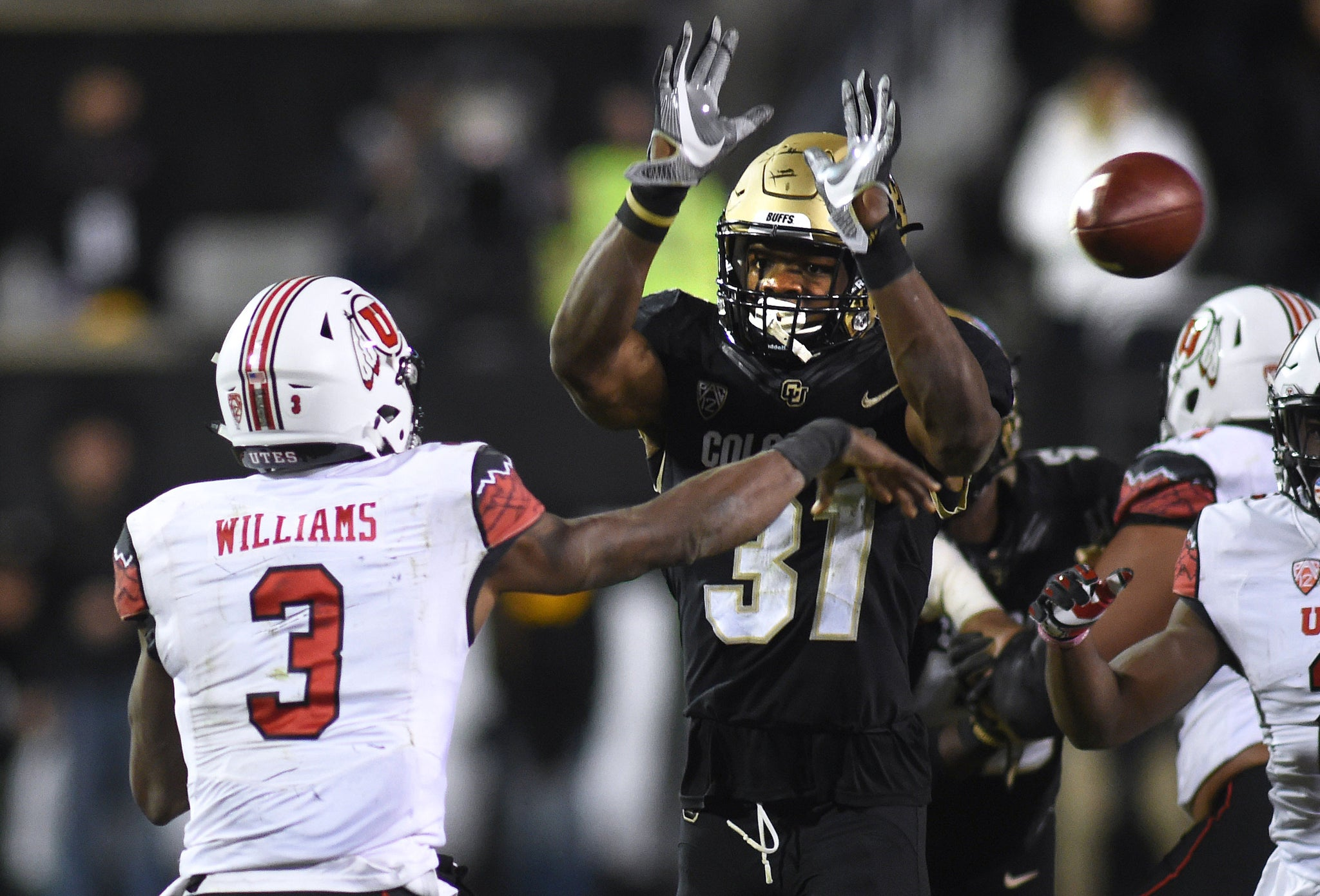 Colorado's Kenneth Olugbode pressures Utah QB Troy Williams. -- Cliff Grassmick