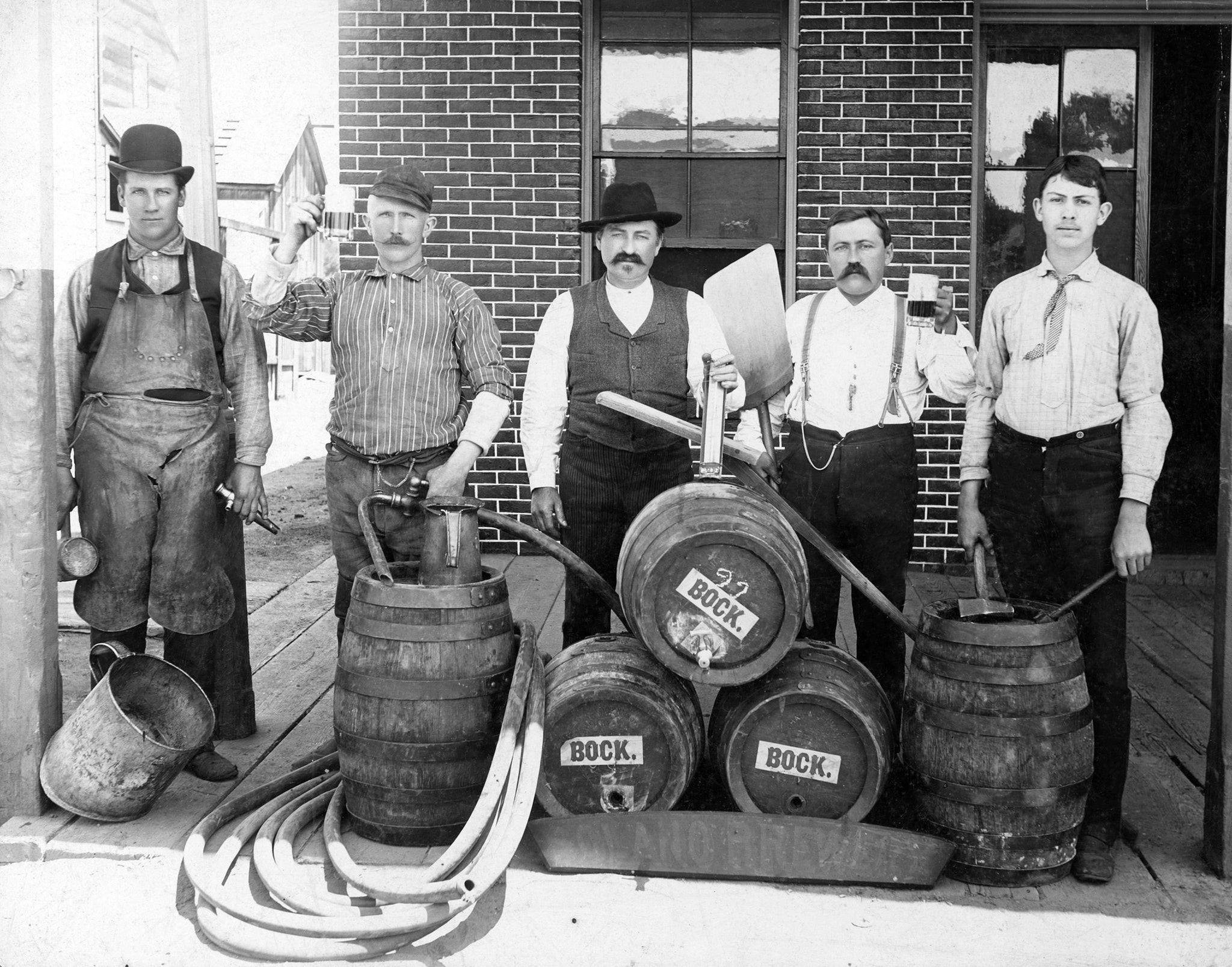 A group of brewery workers in front of the Solano Brewery, Marin Street. From left are Charles Widenmann (proprietor), Chris Bauman, Frank Kleiner, Joe Soans, and unidentified. -- Courtesy of Vallejo Naval and Historical Museum