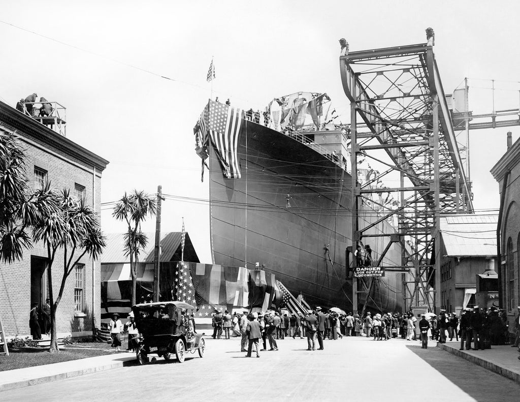 Launching ceremony for the collier USS Prometheus at Mare Island Navy Yard in 1908. At the time of its launch, it was the largest, most expensive ever built at Mare Island. The launching ceremony was followed by a luncheon for 3,000 people. Unfortunately, many of the celebrants were stricken with food poisoning following the banquet. -- Courtesy Vallejo Naval and Historical Museum