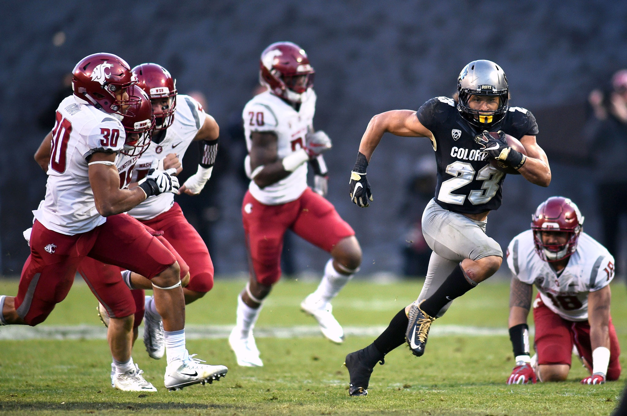Colorado's Phillip Lindsay tries to escape the Washington State defense. -- Cliff Grassmick