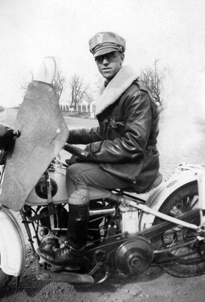 Jack Dickey on his California Highway Patrol motorcycle, Woodland, 1931. Jack was one of the early California Highway Patrol officers. -- Courtesy of Helen Mitchell