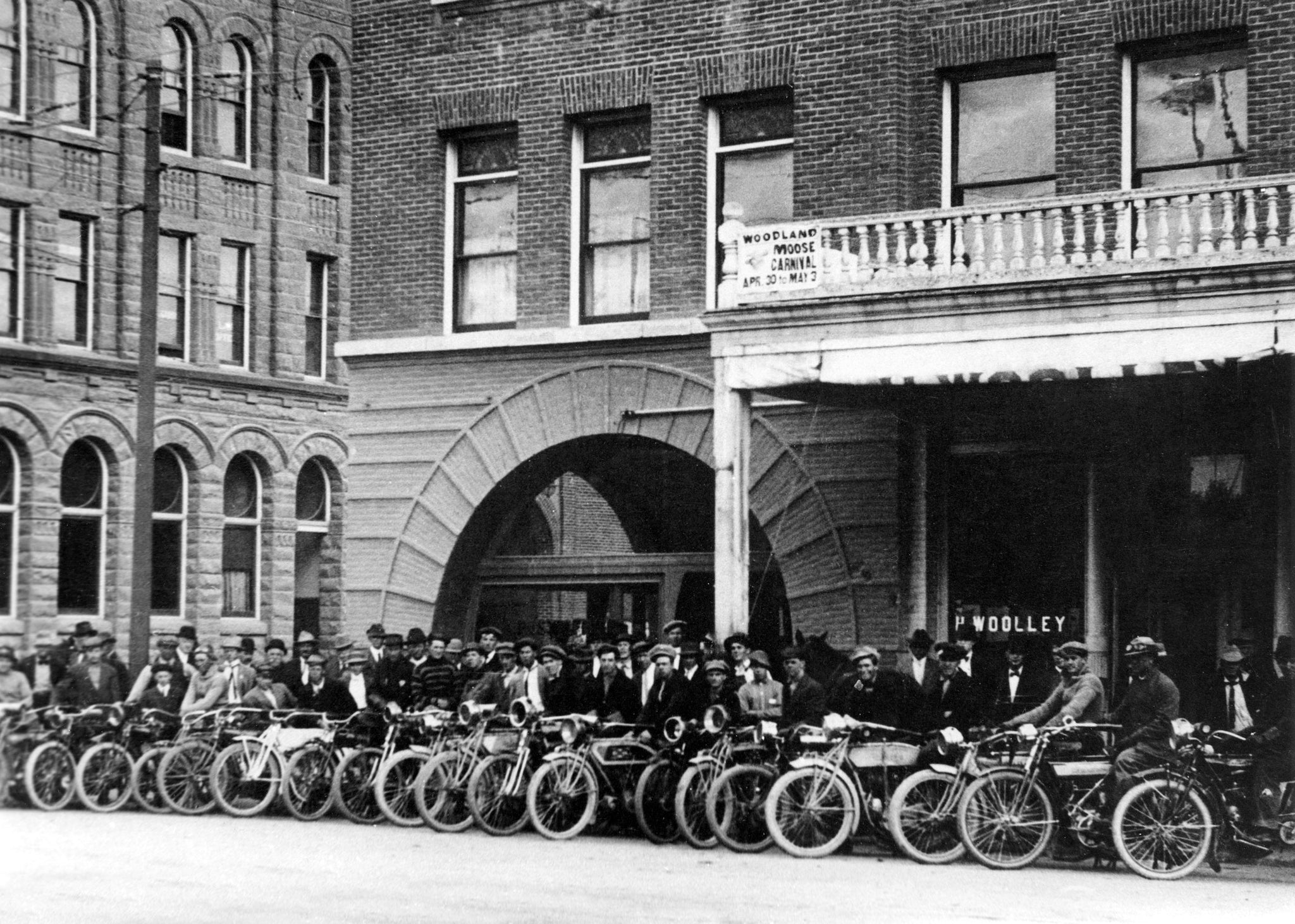 The Yolo County Motorcycle Club in front of the Hotel Julian at the northeast corner of Second and Main Streets, Woodland, 1919. -- Courtesy of the Yolo County