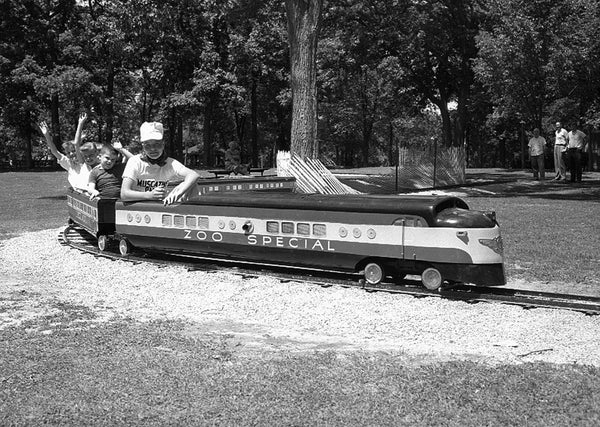 "The ""Zoo Special"" train across from the Weed Park Zoo, 1959. At one time the park also had a small roller coaster. -- Muscatine Journal"