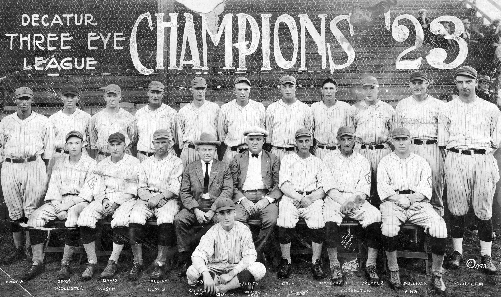 Decatur Commodores, Three-I League Champions of 1923. Front row, from left: Ralph McCollister, Fred Wasem, Lewis, R.W. Heady, Quinn (on ground), Wiley, Chuck Miller, Jack Kotselnick, Don Ping. Back row: Happy Foreman, Dan Gross, Glenn Davis, Ernest Calbert, Glen Harle, Handley, Gray, Fitzgerald, Brenner, Sullivan, John Middleton. -- Decatur Genealogical Society