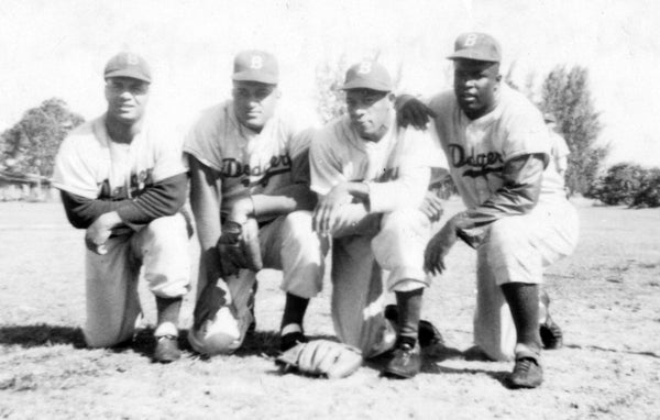 African-American players for the 1950 Dodgers. From left: catcher Roy Campanella, pitcher Don Newcombe, pitcher Dan Bankhead, infielder Jackie Robinson. -- Brady Ballard (Historic Dodgertown)