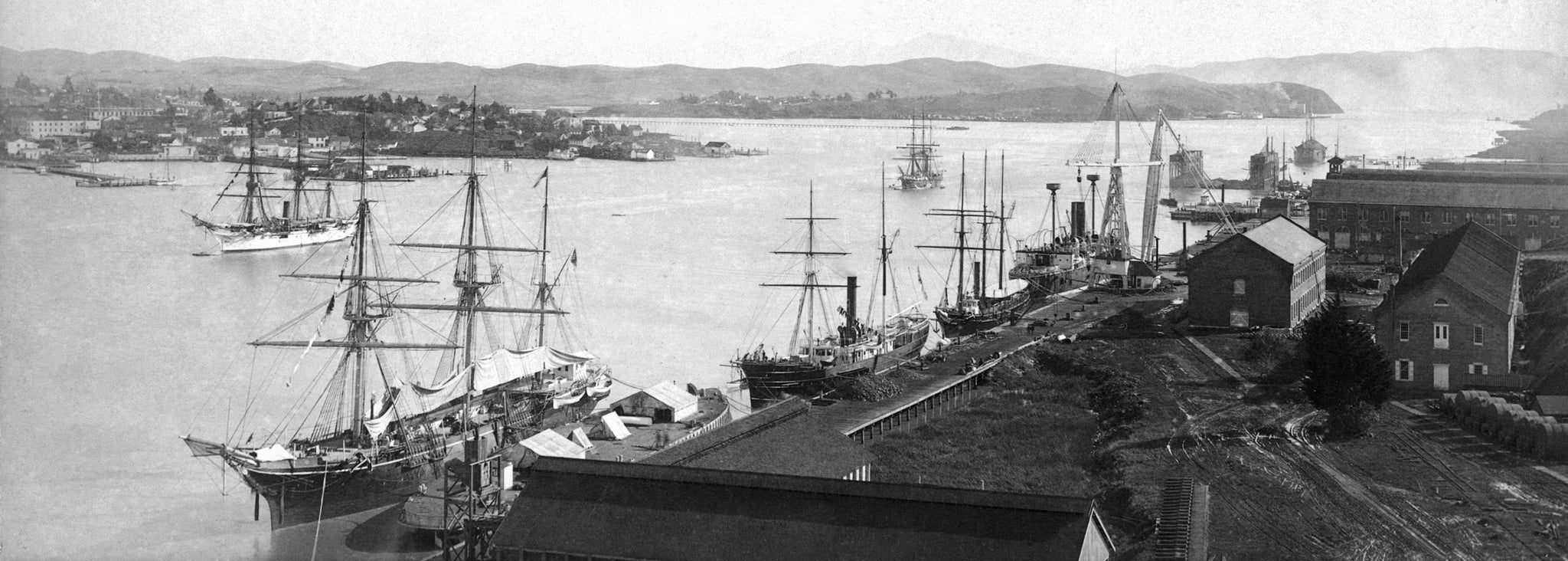 Mare Island waterfront looking south, 1890s. The USS Independence is pictured. Vallejo is visible across the Mare Island Straits. -- Courtesy Vallejo Naval and Historical Museum