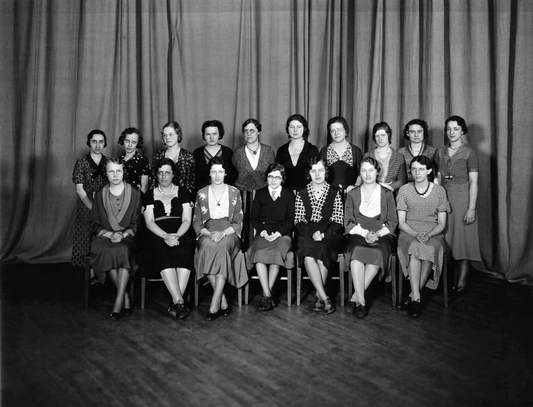 The League of Women Voters at Mankato State Teacher's College, 1933. In the back row: O. Felton, L. Schwan, V. Wahlstrom, D. Kraus, Sara Norriss, B. Anderson, D. Dalsgaard, R. Hegwood, C. Mahal, S. Kanne. In the front row: I. Peterson, P. Lien, H. Byron, R. Babcock, E. Johnson. -- University Archives at Minnesota State University, Mankato