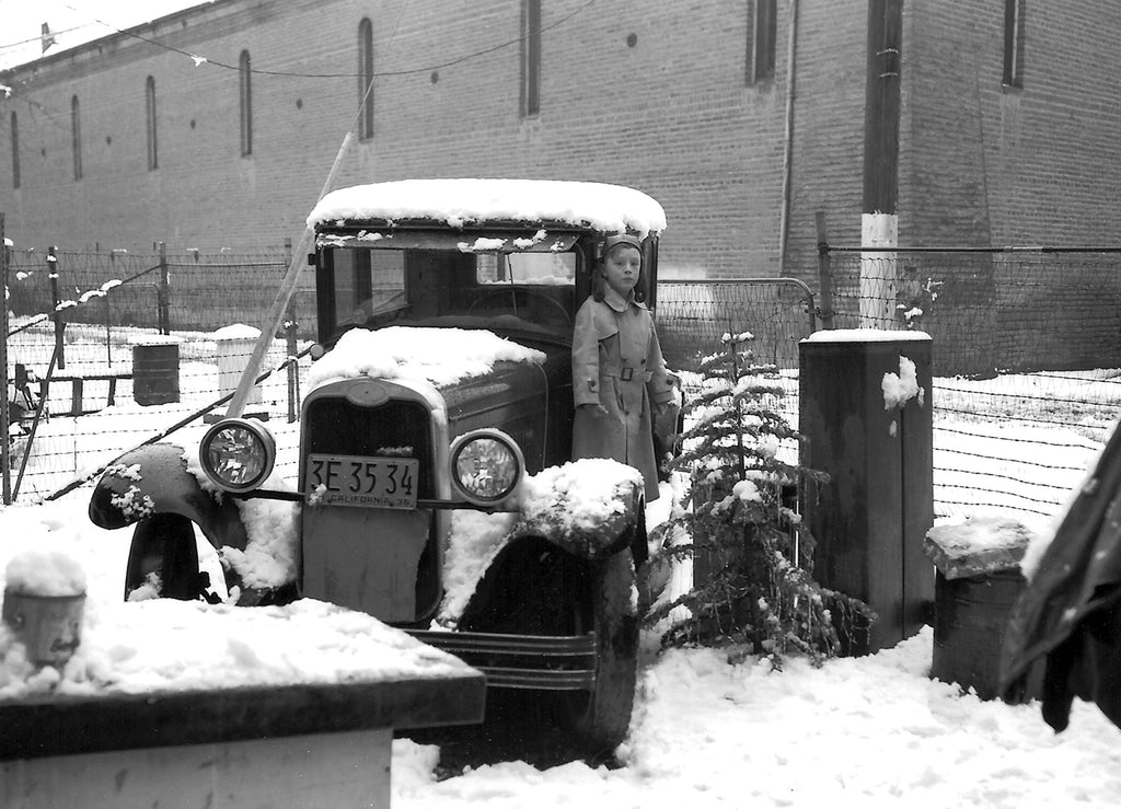 A view of the rear of the old Legion Hall taken from the yard of the Hollingshead Photography Studio at 414 First Street, Woodland, 1936. In the foreground is the 1928 Chevrolet that Paul and Vera Hollingshead drove from New York to California. Paul's eldest son Edward is on the running board. -- Courtesy Bill and Edward Hollingshead; Photo by Paul W. Hollingshead