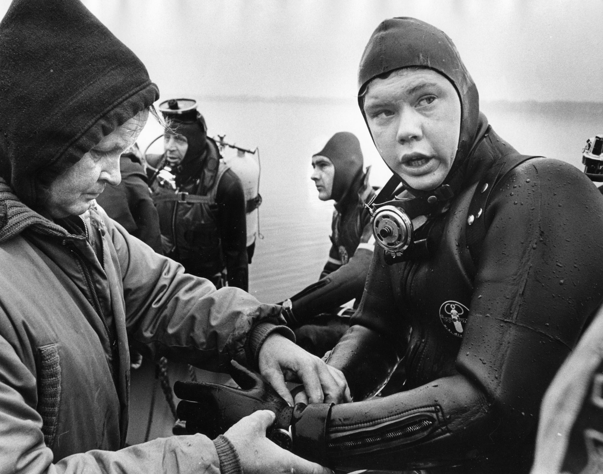 In diving suits, from left, Charles Campbell, Travis Brann and Phil Sharrow following their first dive on soul and R&B star Otis Redding's wrecked Beechcraft H18 aircraft, December 1967.  -- Wisconsin State Journal