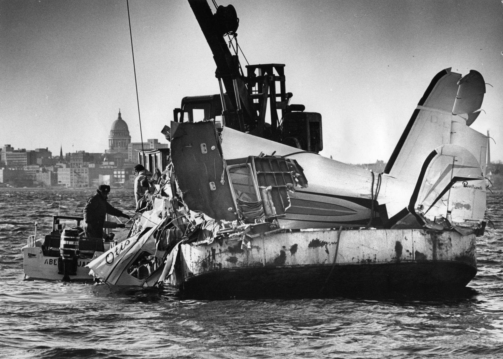 The wreckage of soul and R&B star Otis Redding's Beechcraft H18 aircraft being pulled out of Lake Monona in December 1967. The plane crashed in poor weather on December 10, killing Redding, fellow musicians Matthew Kelly, Jimmy King, Phalon Jones, Ronnie Caldwell, Carl Cunningham, and pilot Richard Fraser. -- Wisconsin State Journal