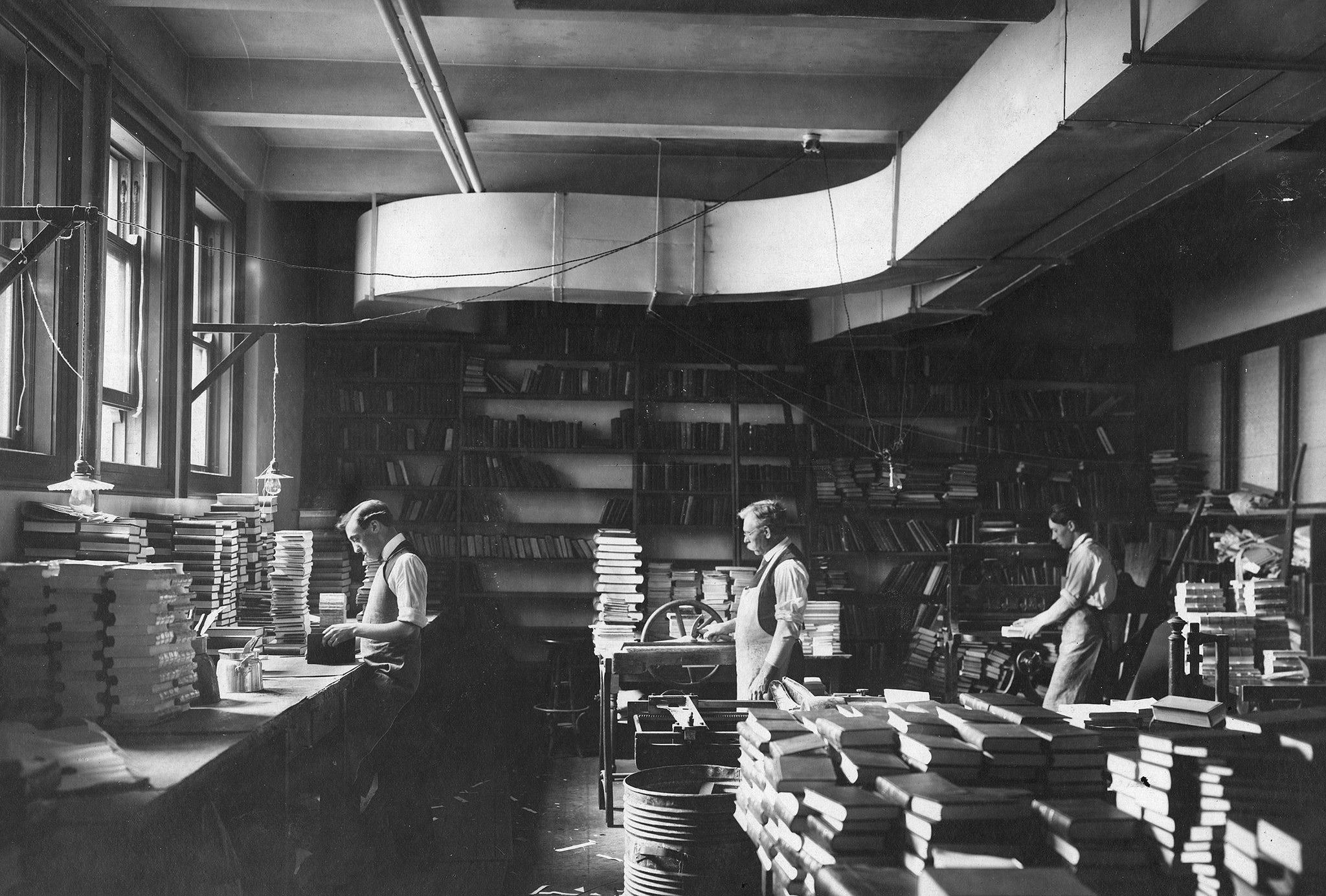 The bindery department at the Central Library, circa 1910, was a busy place and full of books. -- Courtesy Seattle Public Library
