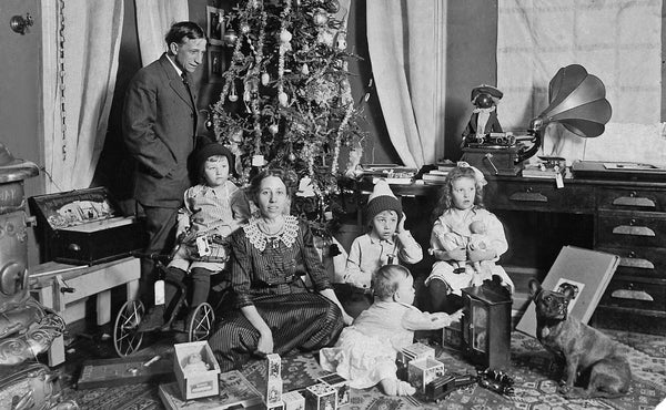 The Burgess family celebrating Christmas in 1913. Included in the photograph are Frank, May, Thomas, William, Edward, and Frances. -- DAVE BURGESS
