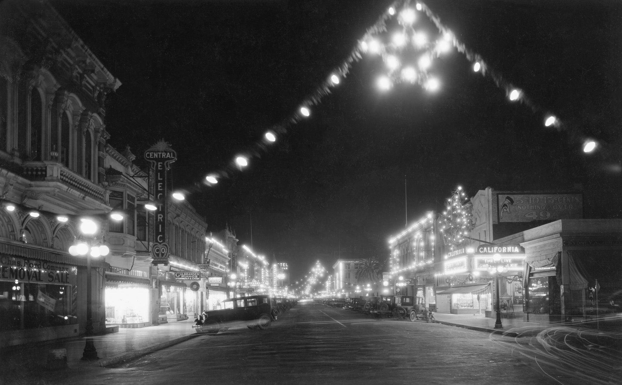 Holiday lighting along Main Street, Watsonville, 1920s. The Central Electric Company is on the left. -- CENTRAL ELECTRIC COMPANY