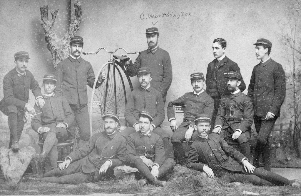 Baltimore High-Wheeler Bicycle Club in the 1870s. Claude Worthington is pictured standing right of the high-wheeler. -- Janice Kaifer