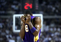 32709a57e ... Lakers Kobe Bryant wipes his sweat against the Pistons in Game 5 of the  NBA Finals ...