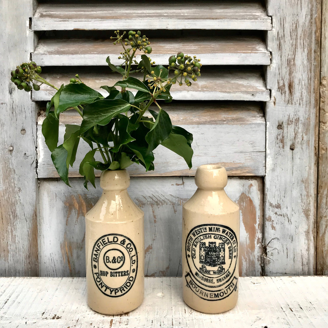 REDUCED Pair of Antique Stone Bottles (sold)