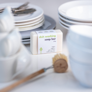 Eco-friendly dishwashing soap bar and brush