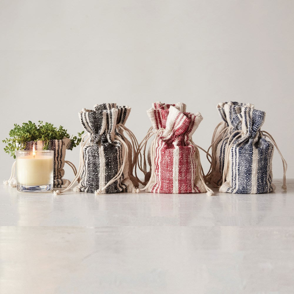 colored striped cotton bagged glass candle
