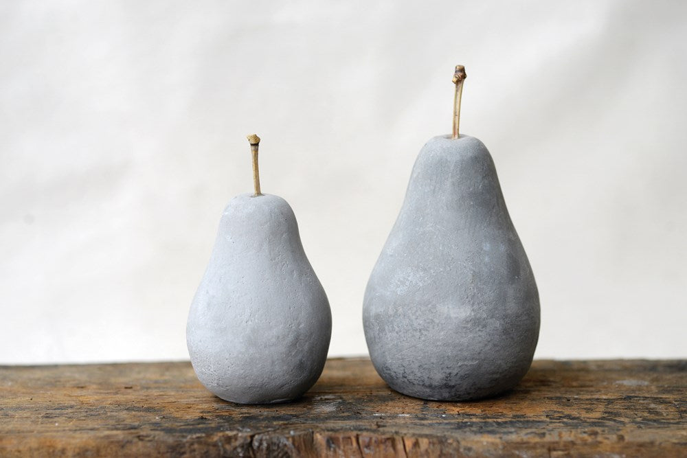 grey cement molded pear. shelving, place card, plate decor. with brown stem