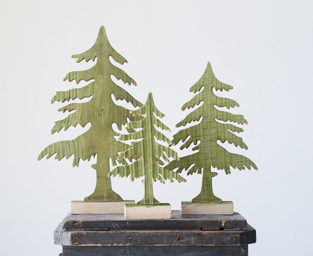 wood cut free standing christmas tree table decor . Natural wood and green.