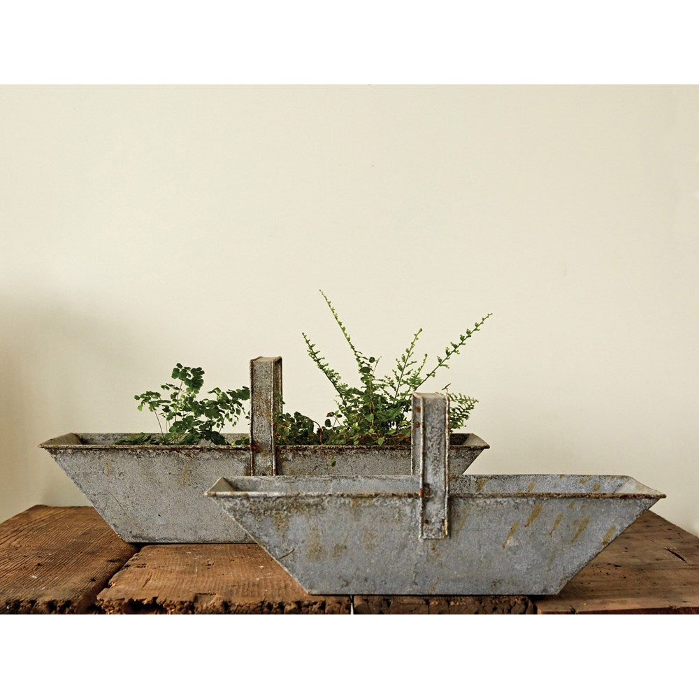 silver zinc distressed metal basket with handle. used for storage or decorative purposes. comes in large and small
